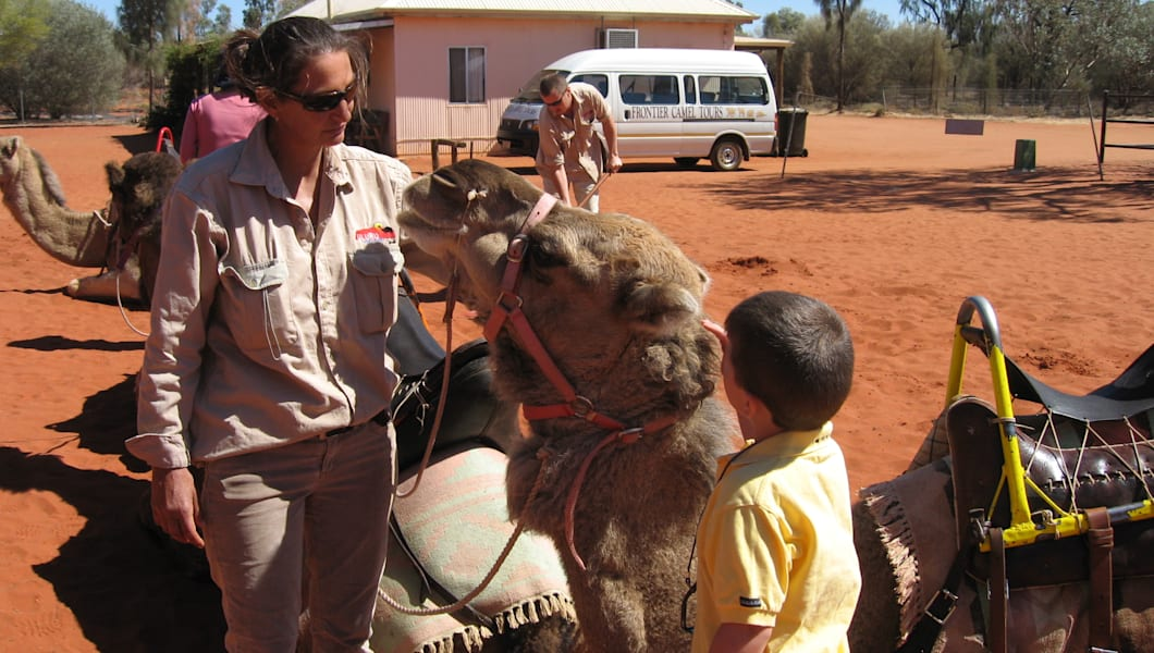 Stay behind the camel's head to avoid camel spit