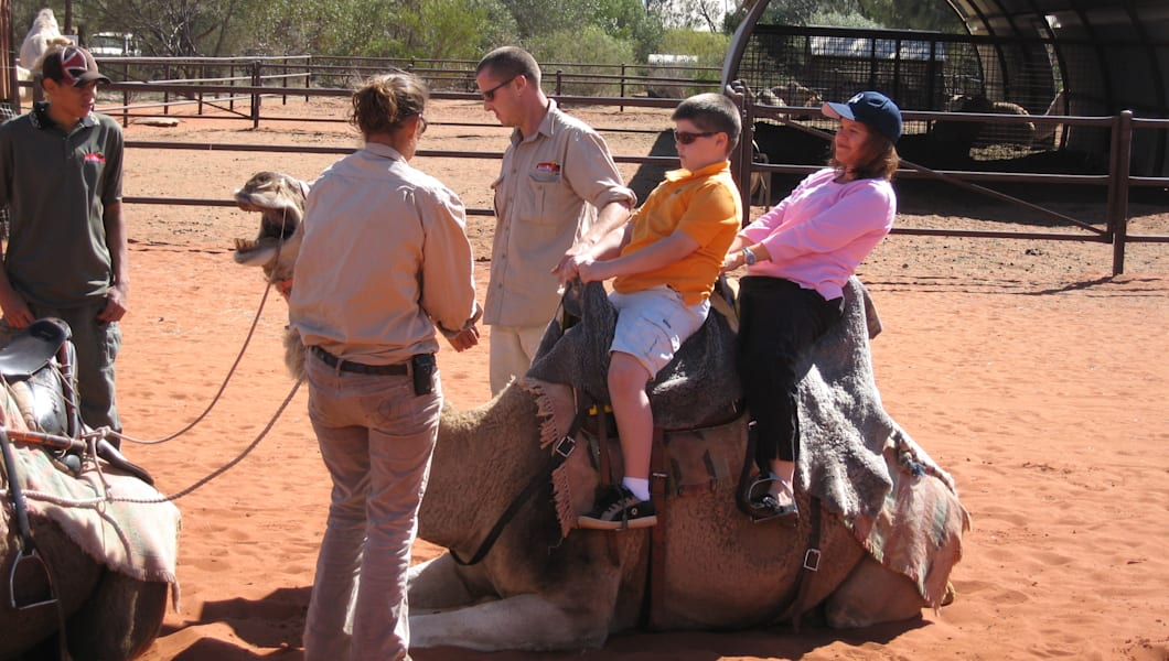 Lean back while the camel stands
