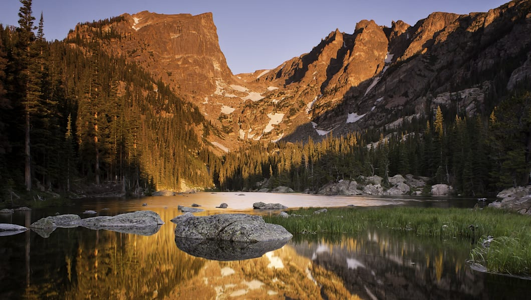 nature landscape shot at sunrise in Rocky Mountain National Park, Alpenglow reflected in a mountain lake. summer in the rocky mountains, Colorado