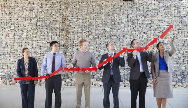 Business people forming upward arrow