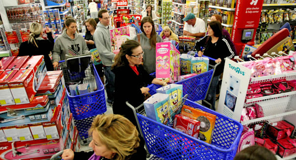 Shoppers in a shopping cart jam looking for 'Door Buster' Christmas deals at Toys ''R'' Us on Thanksgiving Day in Royal Palm Bea