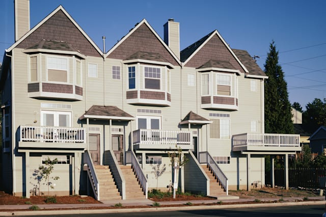  balcony beige blue bow window center chimney color community connected day exterior facade garage homes and gardens horizontal 