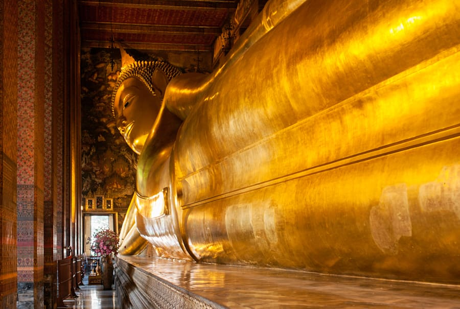 The Temple of the Reclining Buddha is open as usual during the mourning