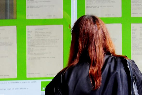File photo dated 17/08/11 of a woman looking into the window of a job centre as job vacancies have continued to increase but a shortage of candidates is emerging, suggesting a