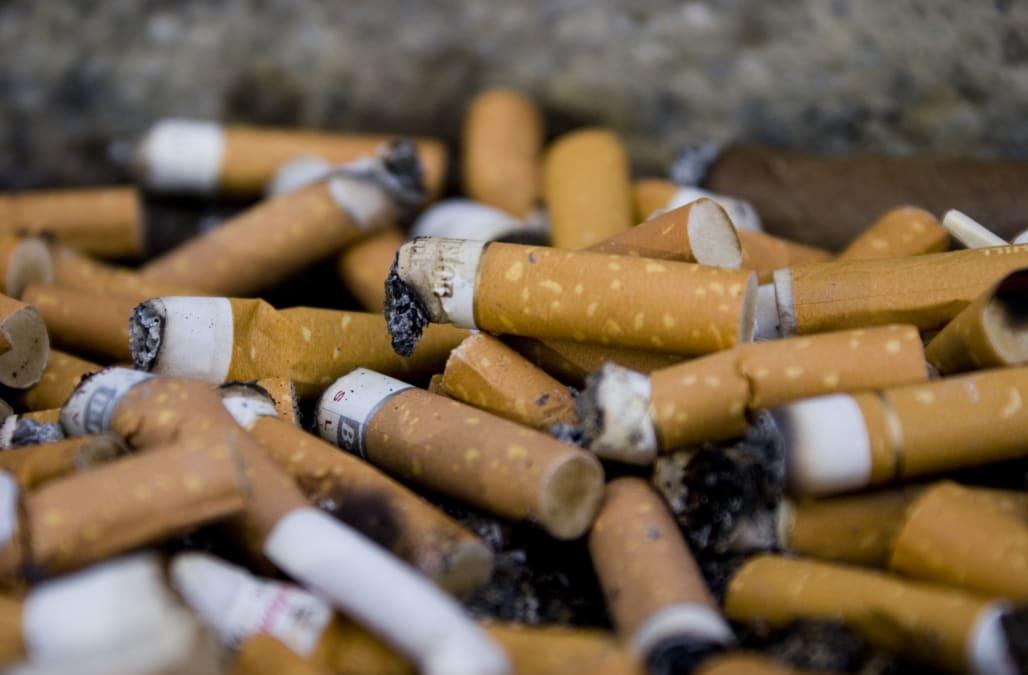 Cigarette butts in outdoor ''ash tray'' in La Defense, Paris, France