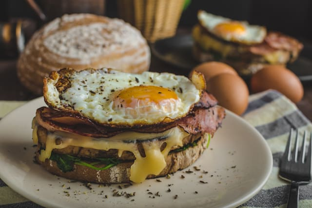Croque madame delicious french breakfast with ham, cheese, egg and spinach with garlic