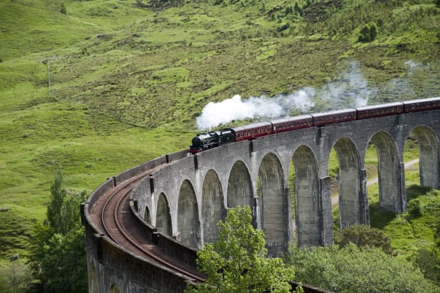 Jacobite steam train on Glenfinnan Viaduct from Fort William to Mallaig.
