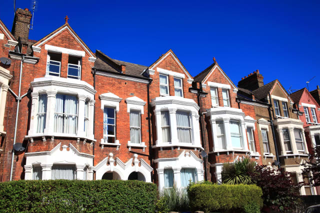 Old fashioned typical Victorian terraced town houses architecture in London, England, UK. These residential homes are often turn