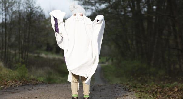 Girl dressed as ghost