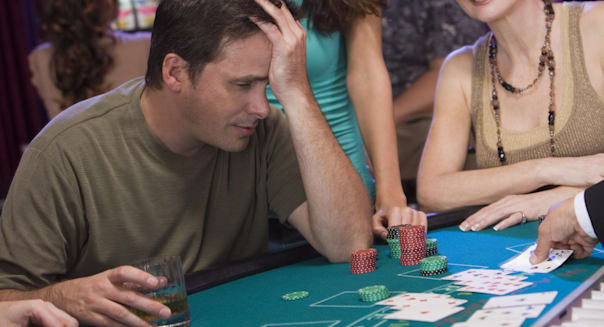 Man at blackjack table with only one chip