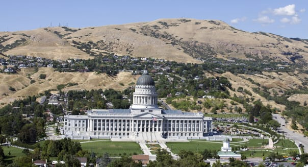Aerial of the Utah Stat Capitol in Salt Lake City Taken from a helicopter on a crystal clear blue sky day