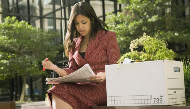 Indian businesswoman reading newspaper