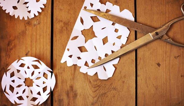 Paper snowflakes and scissors