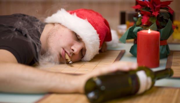 Drunk man in santa's hat