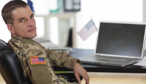 American Soldier in his office
