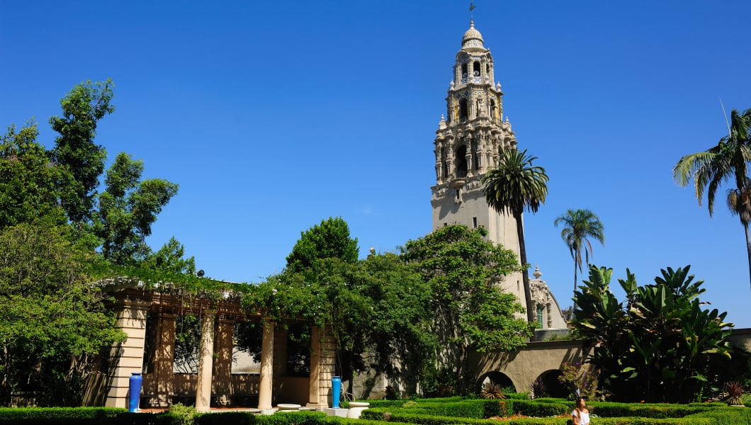 View of the ornate California Tower from the Alcazar Gardens with fountain in foreground in Balboa Park in San Diego