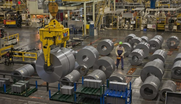 Coiled steel is moved in a warehouse