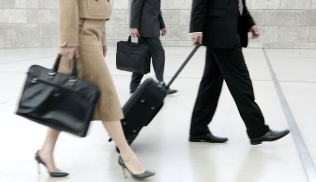 detail of business people with suitcases