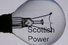 File photo dated 22/10/2013 of a general view of a light bulb with the logo of power company ScottishPower, as the energy firm is reportedly planning to reduce prices by 3.3% after coming under fire for failing to pass on savings from the Government's green levy shake-up. PRESS ASSOCIATION Photo. Issue date: Sunday January 5, 2014. The move will reduce typical household gas and electricity dual fuel bills by around ?40 to ?1,235 for ScottishPower's 2.2 million customers on variable price tariffs, according to The Sunday Telegraph. See PA story CITY Energy. Photo credit should read: David Cheskin/PA Wire