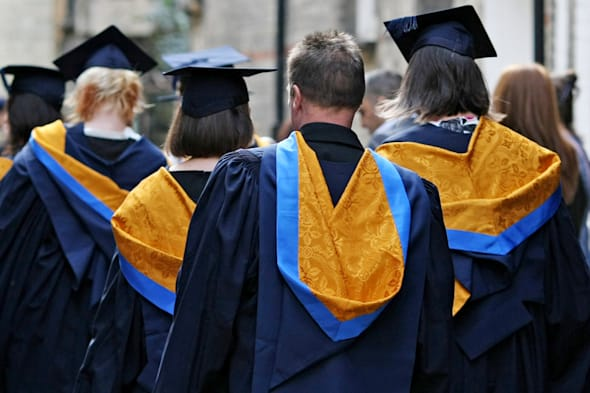 File photo dated 12/10/11 of a general view of students wearing mortar boards and gowns after graduating as would-be students are more likely to decide where to go to university based on job opportunities rather than the prospect of a decent social life. PRESS ASSOCIATION Photo. Issue date: Tuesday March 11, 2014. Almost two thirds (63%) of university applicants say that improving their work chances or pursuing a specific vocation was their main reason for going into higher education, according to a new poll by Which? But less than 1% said that their number one reason for studying for a degree was to have a good social life. See PA story EDUCATION Universities. Photo credit should read: Chris Radburn/PA Wire