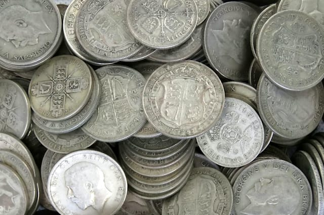 """An auctioneer was stunned when he carried out a routine house clearance and found a hoard of gold and silver worth over £35,000 stashed in a SUITCASE.  See NTI story NTICOINS.  Jonathan Humbert was told the elderly woman had """"a few gold coins"""" but found a suitcase weighing over 40kg (88lbs) behind a sofa filled with treasures.  The lady, who did not wish to be named, said a """"close relative"""" invested in the treasures and left them to her when they passed away.  But the stash, which was amassed over a decade ago in Towcester, Northants., has since quadrupled in value.  There were over a hundred 22-carat gold sovereigns, which cost £200 each, and 17 solid silver bars weighing 1kg (2lbs) that are each worth £450.  Mr Humbert found several kilos of coins - including 22-carat gold Krugerrand that fetch up to £1,200 per ounce - as well as solid silver, half-silver and 22-carat gold British coins.  It took staff at JP Humbert Auctioneers an entire day to sort out the trove on January 25 before it went for auction on Tuesday (31/1)."""
