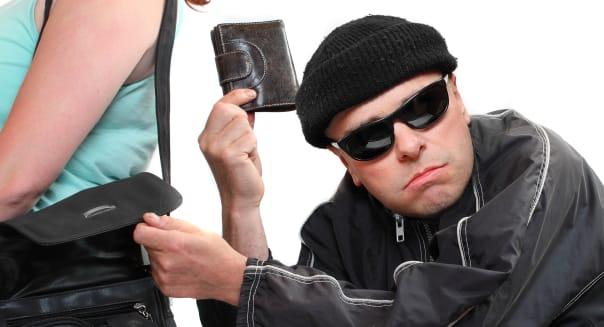 thief stealing from handbag of...