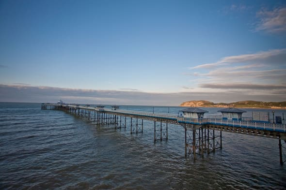 BEST QUALITY AVAILBLEUndated handout photo issued by Finn PR of Llandudno Pier, one of three piers which have been put on the market by owners Cuerden Leisure for a collective asking price of �12.6 million. PRESS ASSOCIATION Photo. Issue date: Thursday March 12, 2015. Blackpool Central Pier - home to the famous 33 metre high (108ft) Ferris wheel and the closest of three piers to Blackpool Tower - Blackpool South Pier and Llandudno Pier in Wales, were all constructed in the 19th century. Llandudno, which is 695 metres long (2,280ft), is the only pier which is grade two listed, meaning any future owners would require Listed Building Consent to make changes to the structure. Blackpool Central Pier, which stands at 341 metres long (1,118ft), and Blackpool South Pier, which is 150 metres long (492ft), do not benefit from listed status, despite opening in 1864 and 1892 respectively. See PA story HERITAGE Pier. Photo credit should read: Finn PR/PA WireNOTE TO EDITORS: This handout photo may only be used in for editorial reporting purposes for the contemporaneous illustration of events, things or the people in the image or facts mentioned in the caption. Reuse of the picture may require further permission from the copyright holder.