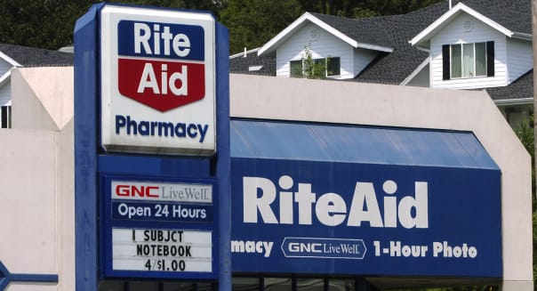 A sign stands outside a Rite-Aid pharmacy in Camp Hill, Penn