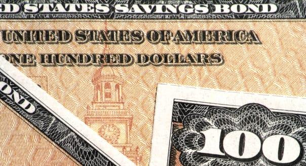 closeup view of 100 dollar us savings bonds; Shutterstock ID 1622532; PO: DF treasury  america; banking; bond; cash; ee; hundred