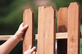 |arm|brown|business|caucasian|color|construction|day|durability|erecting|exterior|fence|hand|holding|homes and gardens|horizonta