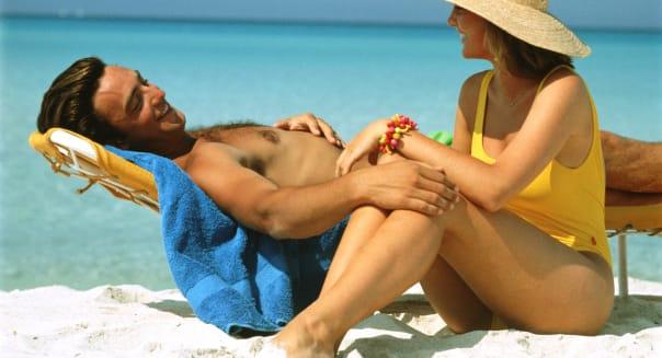  adult beach blue caucasian center color couple day exterior hat honeymoon horizontal lifestyle lounge chair man ocean people pe