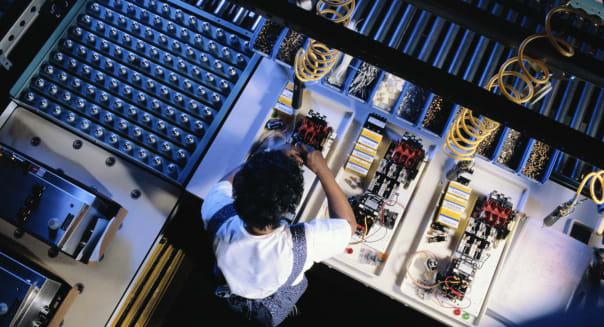 Title:  Worker Manufacturing Electronic PartsCreative image #:  BU004786License type:  Royalty-freePhotographer:  Kim Steel