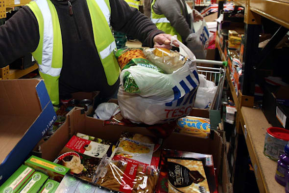 File photo dated 20/12/11 of workers at a Food Bank. More than a third of all councils in England and Wales are subsidising food banks - setting aside almost ?3 million in recent years, an investigation has found. PRESS ASSOCIATION Photo. Issue date: Monday March 3, 2014. The local authorities have set aside ?2.9 million of public money over the last couple of years to combat food poverty, according to BBC Panorama. While the Government says that food banks are not part of the welfare system, the programme asked all 375 councils in England and Wales about food banks and 323 responded, and of those, 140 said they were providing funding. See PA story POLITICS Foodbanks. Photo credit should read: David Jones/PA Wire