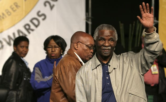 South Africa's President Thabo Mbeki waves to supporters before the announcement of the new ANC leader...