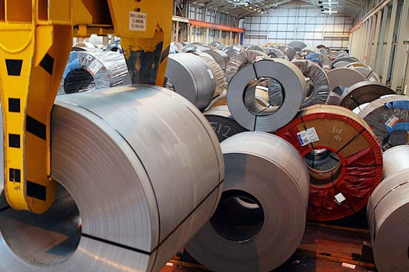 File photo dated 06/03/02 of steel at a site near Wolverhampton as pay rises in manufacturing firms are higher than last year, suggesting the green shoots of recovery are
