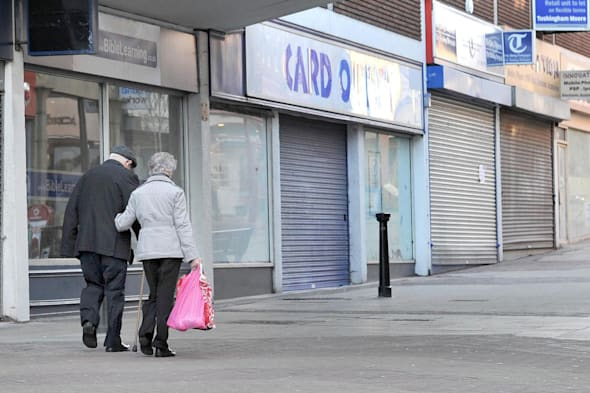 File photo dated 13/12/11 of people walking past closed shops as a project has been launched to encourage young people to consider opening a high street business to help revitalise