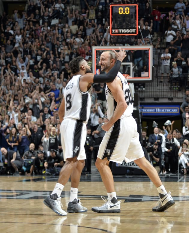 The bad haircut competition between Manu Ginobili and Mills was too close to