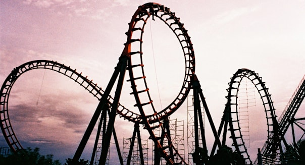 View of roller coaster ride at sunset.