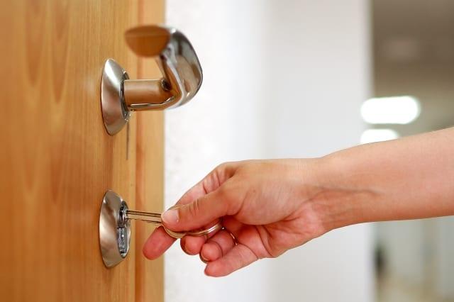 locking up or unlocking door...