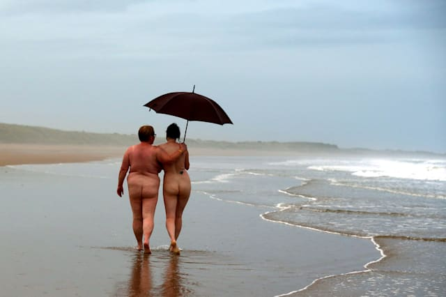 More than 400 strip off for chilly annual skinny dip