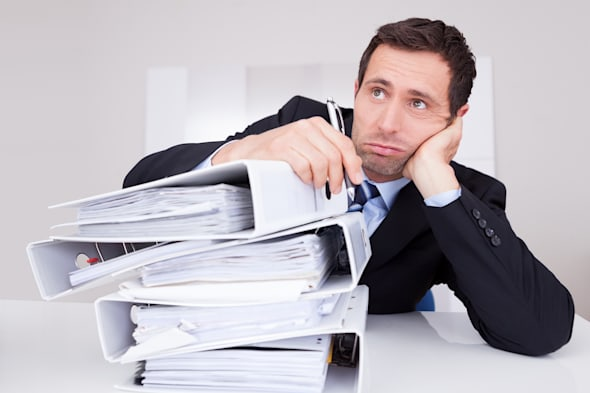 bored businessman overwhelmed...