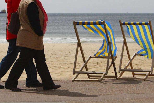 File photo dated 03/05/10 of two women walking along the beach in Bournemouth as one in 12 people planning to retire this year will still be paying off their mortgage. PRESS ASSOCIATION Photo. Issue date: Friday January 24, 2014. Prudential, which carries out research each year to gauge the state of people's finances as they approach retirement, found that one in six (17%) people ending their working lives in 2014 will still be burdened with some form of debt, including mortgages, credit cards or personal loans. Some 8% of those planning to retire in 2014 said they still have not fully paid off their mortgage and around 10% still have credit card debt piled up. On average, those who still have some form of mortgage and/or non-mortgage debt owe ?24,800, although this figure is around one fifth (21%) lower than the typical debt in 2013 of ?31,200, researchers found. Across Britain, Scotland had the highest rate of people retiring this year with debts outstanding. Nearly one quarter (24%) of people retiring in 2014 there said they would have some form of debt. See PA story MONEY Retire. Photo credit should read: Chris Ison/PA Wire