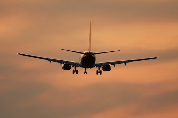 holiday scams on the increase airliner against sunset sky