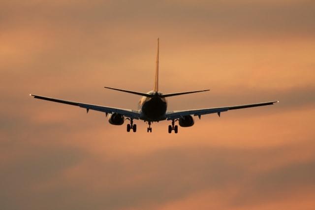 airliner against sunset sky