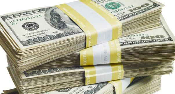 A stack of bundled of 100 US dollar bills