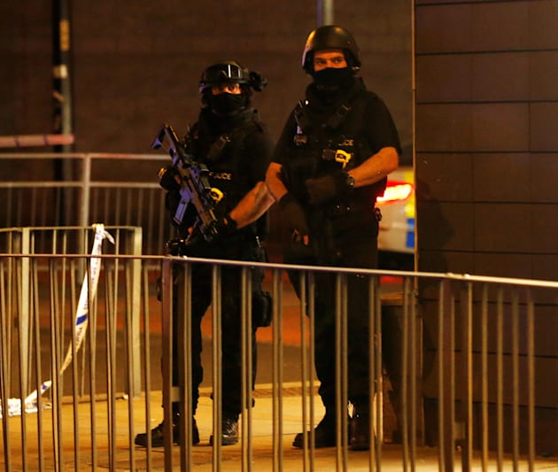 Armed police officers guard the area, which has been cleared of civilians and cordoned