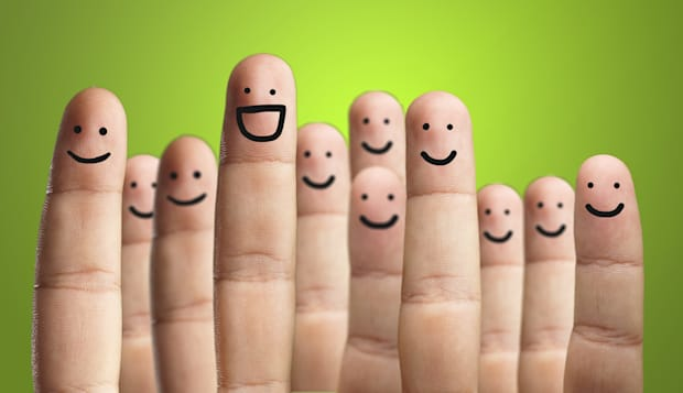 close up of fingers with smiley ...