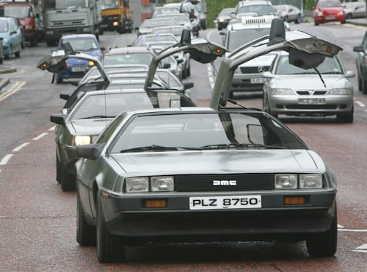 A convey of More than 70 Delorean motor enthusiasts,makes its way through Belfast city centre,Friday 26th May 2006,the car enthu
