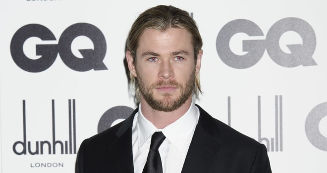 Chris Hemsworth arrives for the GQ Men of the Year Awards at a central London venue, Tuesday, Sept. 4, 2012. (AP Photo/Jonathan Short)