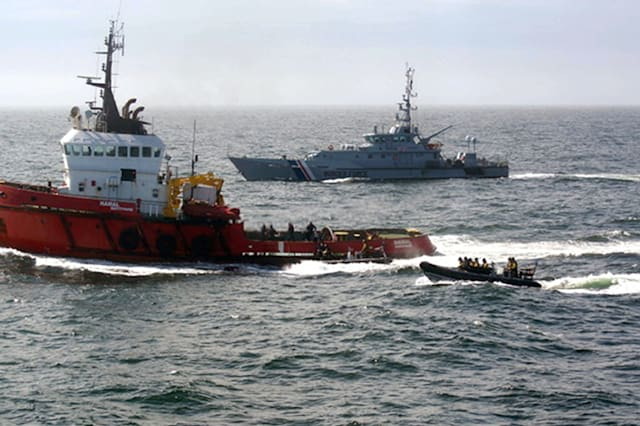 National Crime Agency handout photo dated 23/04/15 of the ocean-going tug MV Hamal (left) as it was intercepted by the frigate HMS Somerset and Border Force cutter Valiant (right) about 100 miles east of the Aberdeenshire. Cocaine which could be worth more than �500 million has been recovered from a ship intercepted at sea in what is believed to be the UK's biggest class-A drug seizure. PRESS ASSOCIATION Photo. Issue date: Thursday April 30, 2015. More than three tonnes of the drug were recovered from the MV Hamal in the North Sea in a joint operation involving the National Crime Agency (NCA) Border Force and Royal Navy. See PA story SEA Cocaine. Photo credit should read: NCA/PA WireNOTE TO EDITORS: This handout photo may only be used in for editorial reporting purposes for the contemporaneous illustration of events, things or the people in the image or facts mentioned in the caption. Reuse of the picture may require further permission from the copyright holder.